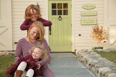 Megan Matsen of Millbrook with her two-year-daugher, Nora, and four year old daughter, Molly (standing)
